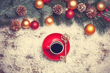 Cappuccino with and key on artificial snow background