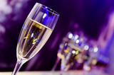 Luxury party champagne glass in nightclub neon lights.