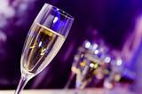 Fototapety Luxury party champagne glass in nightclub neon lights.