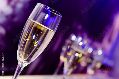 Luxury party champagne glass in nightclub neon lights. - 74209759