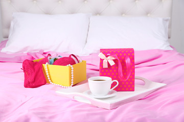 Seductive lingerie in present box and tray with cup of coffee