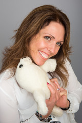 Pretty woman hugging stuffed seal
