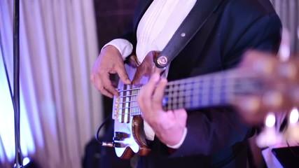 SLOW MOTION: Musician playing bass guitar