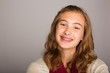 happy teenage girl wearing braces - 74211947
