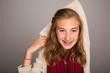 teenage girl holding arm behind head