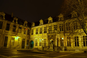 Illuminated building of the former library in antwerp.