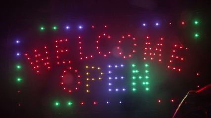 Christmas holidays lights blinking shop sign welcome open