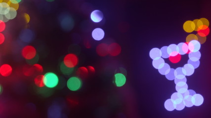 Christmas holidays lights blinking out of focus background