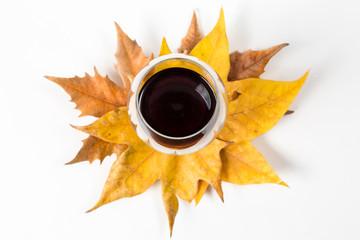 Wineglass on maple leaves