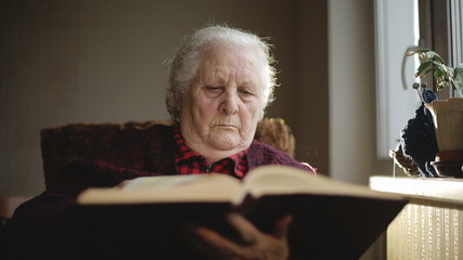 Old human reading a book.