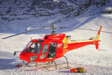 Red helicopter landed at swiss ski resort near Jungfrau mountain