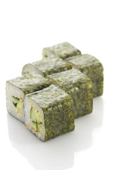 Sushi maki with cucumber and sesame isolated