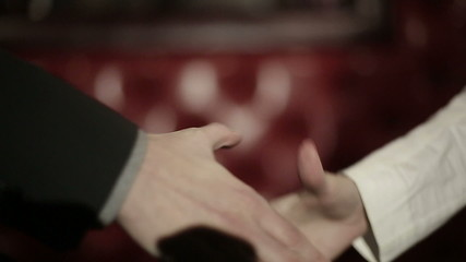 Business partners man and women doing a handshake. Slow motion