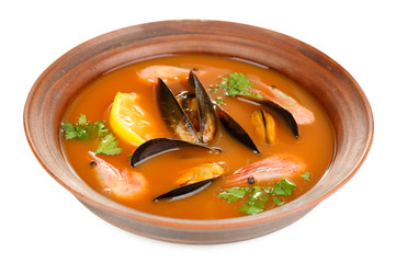 Tasty mussel soup with shrimps in bowl isolated on white
