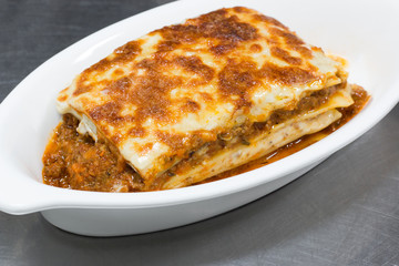 italian lasagna on white plate