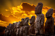 Standing moais with orange clouds in background in Easter Island