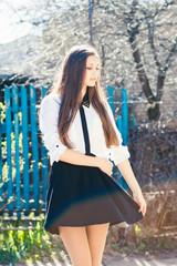 Beautiful girl in skirt walking on the street