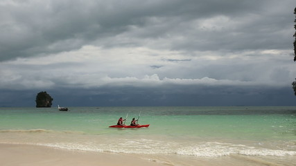 kayaks float in the azure waters off the coast of the island and