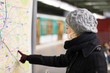 Lady looking on public transport map panel. - 74222122