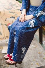Wearing kimono and geta shoes