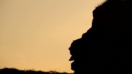 Silhouette of people on the hill