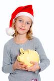 girl with Santa- cap and piggy bank