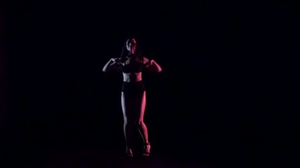 Sexy woman dancing, dark background. Slow motion.
