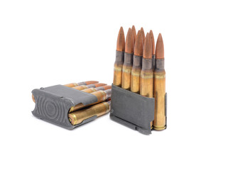 M1 Garand clips and ammunition on white background.