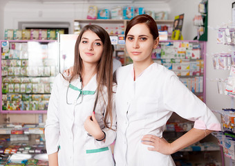 Two happy pharmacist young women