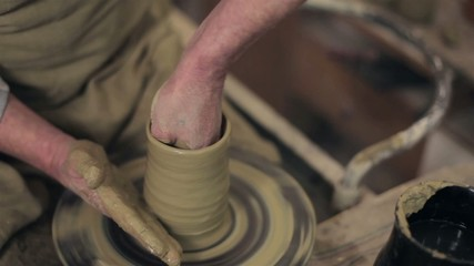Master making a pot from clay