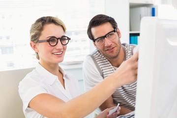 Photo editors looking at computer screen