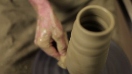 Mastering a pot for flowers from clay