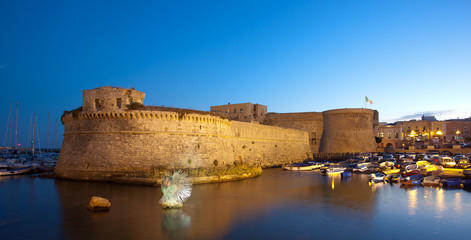 Angevin Castle of Gallipoli by night in Salento, Italy.