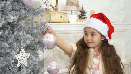 happy smiling little girl decorated new year tree