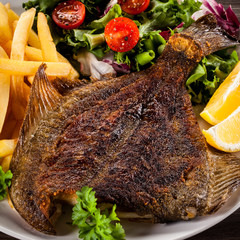Fish dish - fried flounder, chips and vegetables