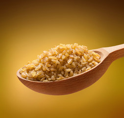Bulgur in a wooden spoon