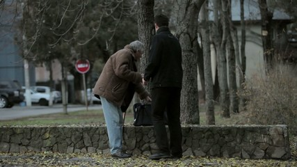 Helping old man in the street
