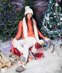 beautiful girl sitting  near  Christmas tree