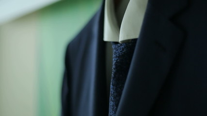 men's suit hanging on the hanger