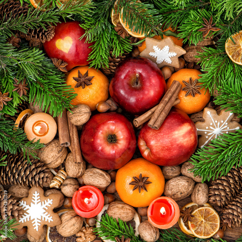 canvas print picture Christmas decoration with candles. Fruits, nuts, spices and cook