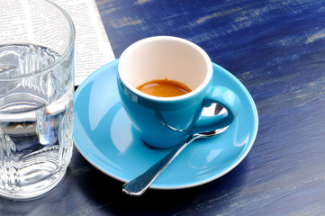 cup espresso with glass of water