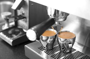Making espresso on stainless steel espresso machine.