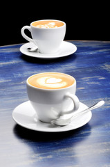 latte on a blue wood table