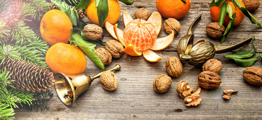 mandarine fruits and walnuts with christmas decorations