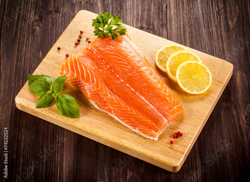 Fototapeta Fresh raw salmon fillet on cutting board