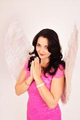 Christmas sexy girl angel praying, smiling seductively