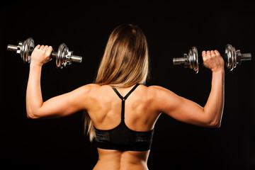 attractive young woman working out with dumbbells - bikini fitne © Samo Trebizan