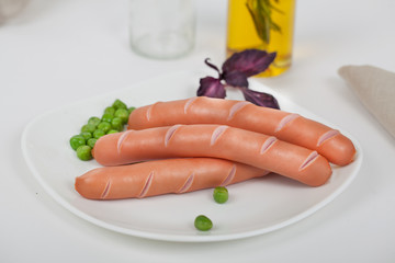sausages with vegetables on a plate