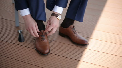 The man wears shoes. Close up