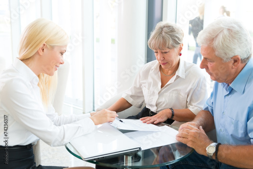 Elderly couple purchasing life insurance - 74236317